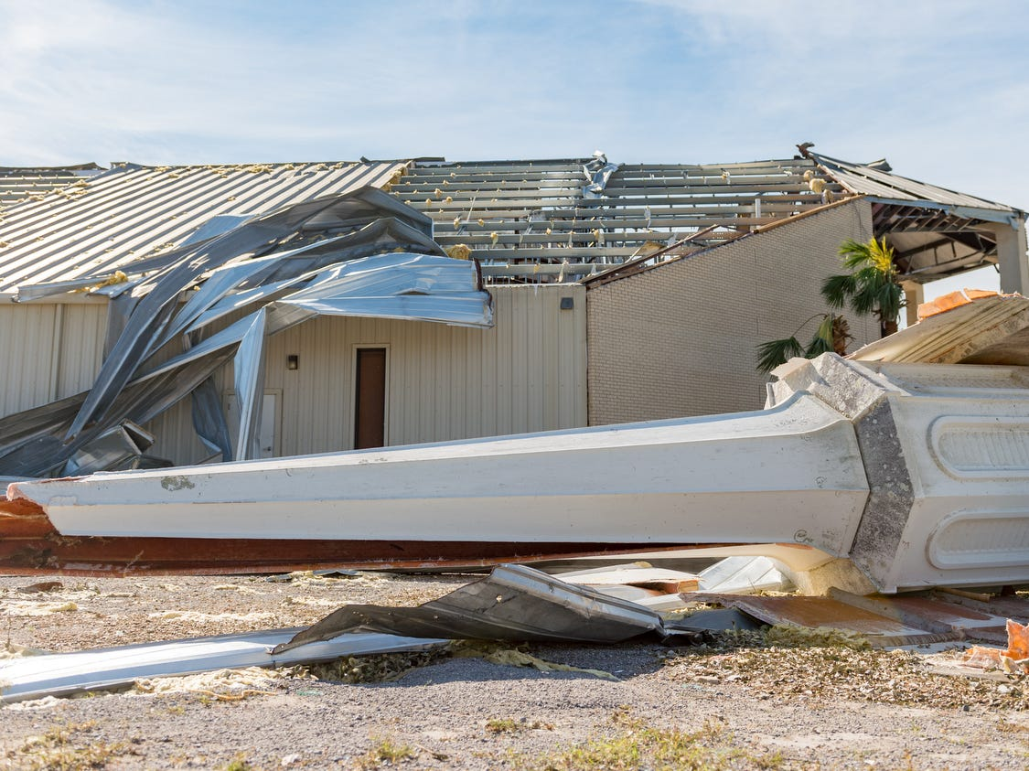 The church steeple lies damaged beside the building, in Panama City Fla., Friday.