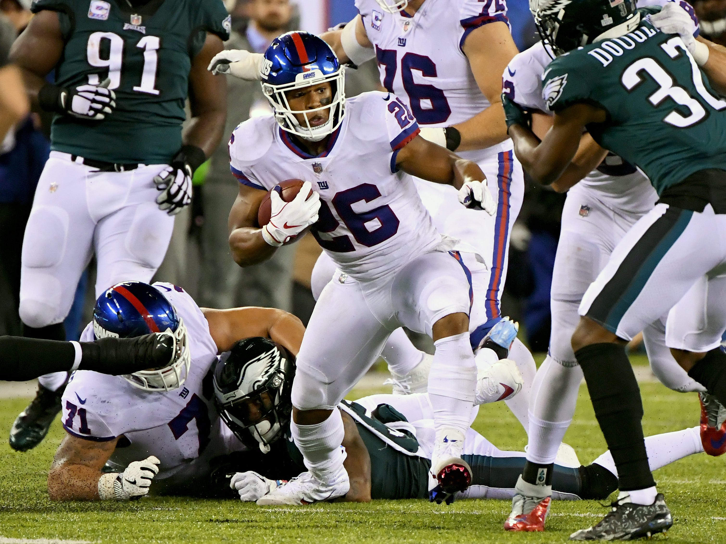 New York Giants running back Saquon Barkley runs the ball against the Eagles in the second quarter at MetLife Stadium.