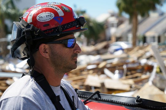 """Carlos """"Puma"""" Pumariega, an urban search-and-resuce task force member, surveys the damage in Mexico Beach on Oct. 12, 2018, following the passage of Hurricane Michael."""