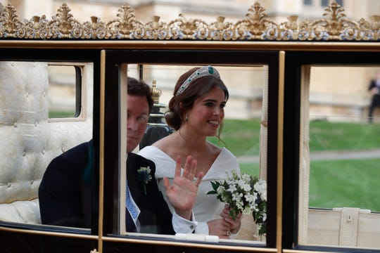 Princess Eugenie of York and her new husband Jack Brooksbank in the Scottish State Coach at the start of their carriage procession following their wedding at St George's Chapel, Windsor Castle in Windsor, on Oct. 12, 2018.