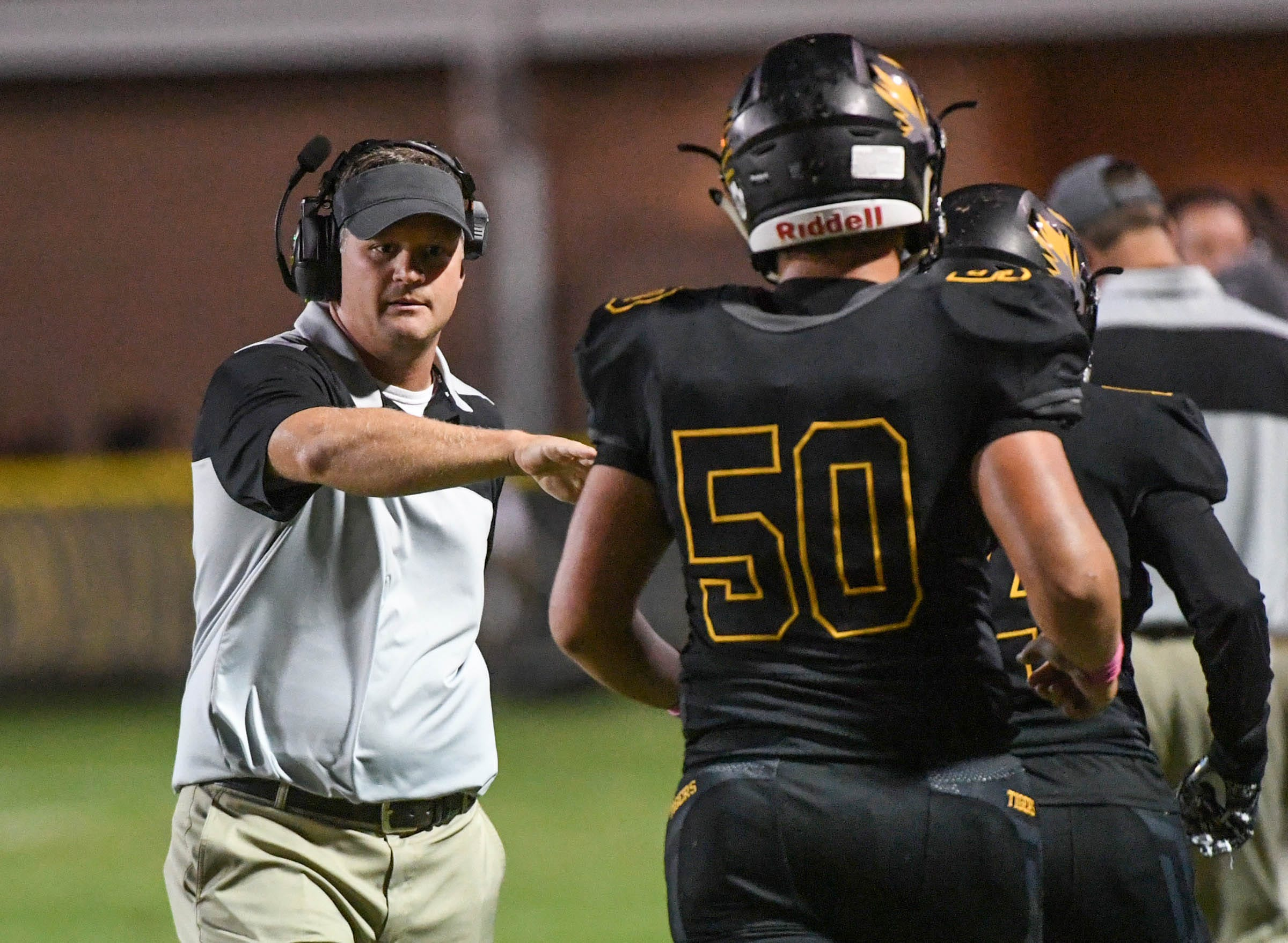 Crescent head coach Sheldon Evans congratulates Crescent senior Dawson Hanks after the team scored a touchdown during the fourth quarter at Crescent High School in Iva on Friday, October 12, 2018.