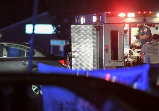 Medshore workers tend to a man in the ambulance after Anderson County Sheriff Deputies and SWAT team members were in a standoff situation with him in the parking lot of the Stop-A-Minit on S.C.24 and S.C.28 Bypass in Anderson on Friday, October 12, 2018.