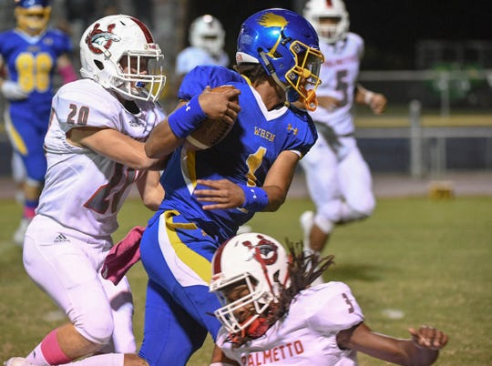 Palmetto Chase Froedge chases Wren senior quarterback Tyrell Jackson (1) during the first quarter at Wren High School in Piedmont on Friday, October 12, 2018.