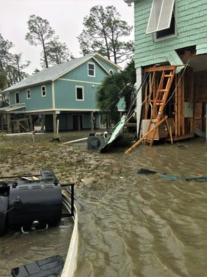 Houses in Indian Pass, Florida, in the aftermath of Hurricane Michael. Local resident Jim Smolenski rode out the storm in his beach house adjacent to where these pictures were taken.