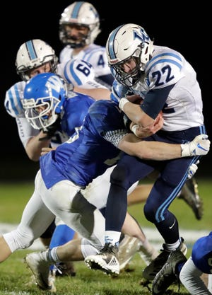 Little Chute's Bryce Schumacher (22) runs for extra yards against Wrightstown on Oct. 12 in Wrightstown. The Mustangs are ranked No. 1 in the Division 3-7 rankings in the Post-Crescent coverage area.