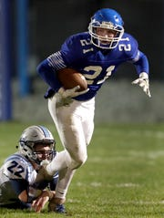 Wrightstown's Ben Jaeger tries to break away from Little Chute's Bryce Schumacher during their North Eastern Conference football game Friday in Wrightstown.  Wm. Glasheen/USA TODAY NETWORK-Wisconsin.