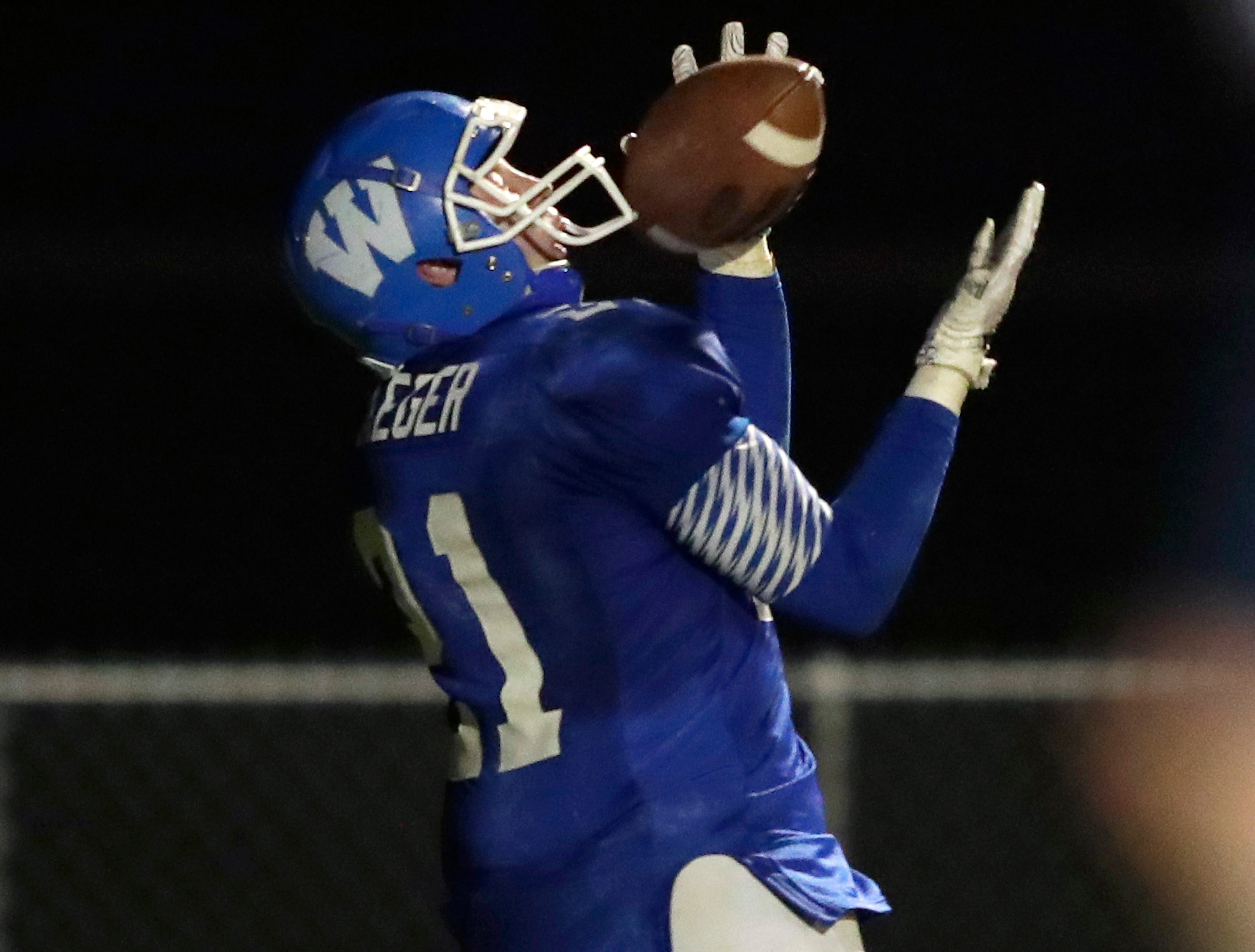 Wrightstown High School's #21 Ben Jaeger against Little Chute High School during their North Eastern Conference football game on Friday, October 12, 2018 in Wrightstown Wis. 