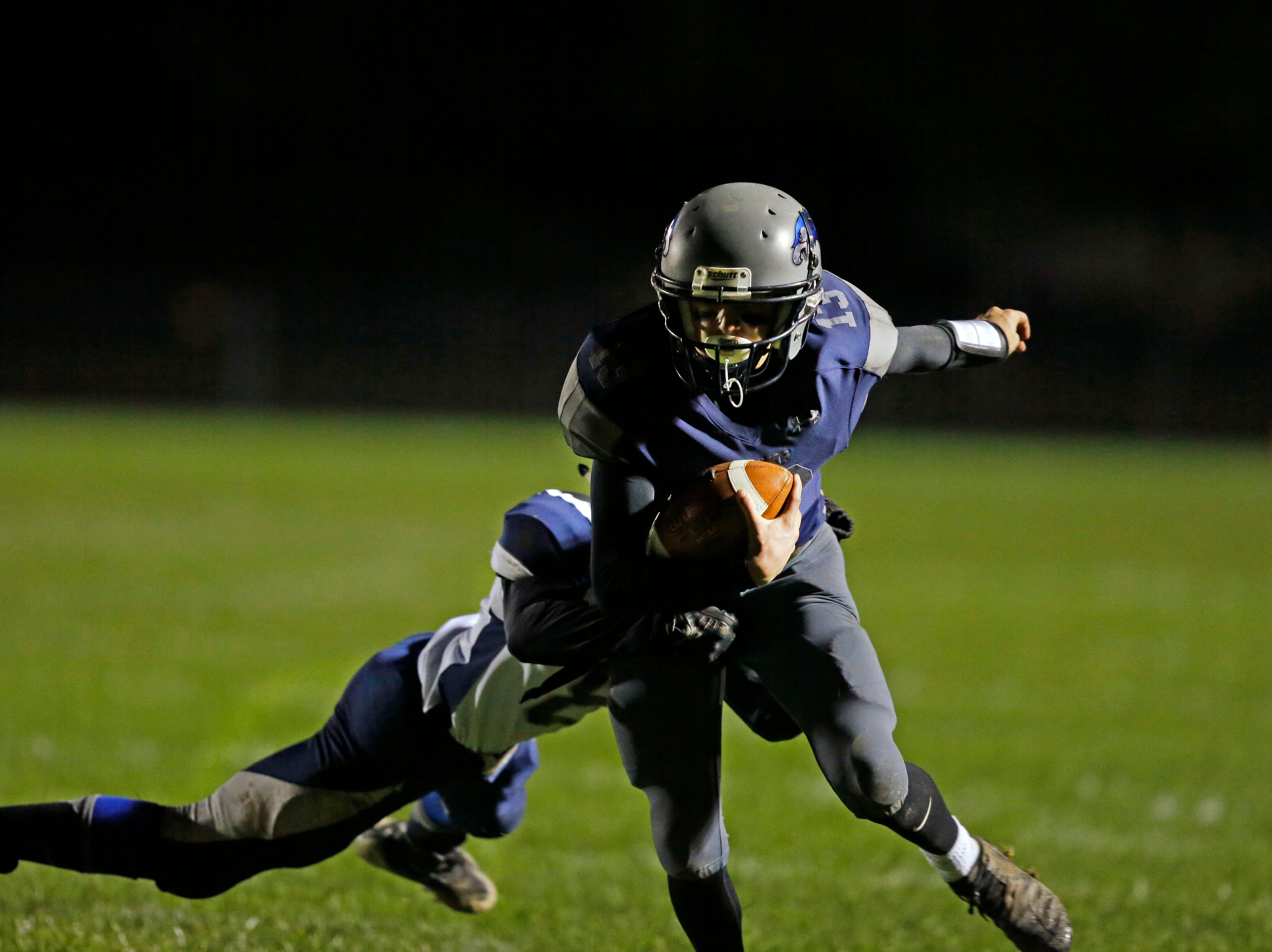 Ray Zuleger of Xavier, gets away from Terry Schmidt of Waupaca, as he runs for a touchdown in a Bay Conference football game Friday, October 12, 2018, at Rocky Bleier Field in Appleton, Wis.