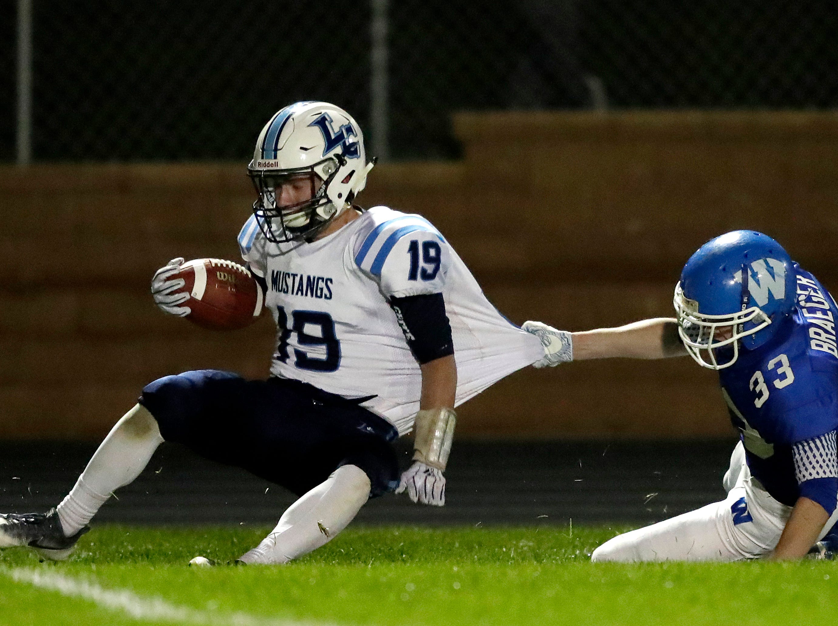 Little Chute High School's #19 Jacob Lillge against Wrightstown High School's #33 Will Braeger during their North Eastern Conference football game on Friday, October 12, 2018 in Wrightstown Wis. 