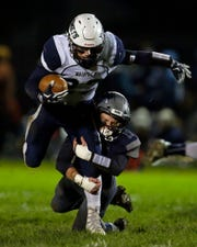 Sam Loken of Xavier tackles Jack Menzies of Waupaca in a Bay Conference football game Friday in Appleton.