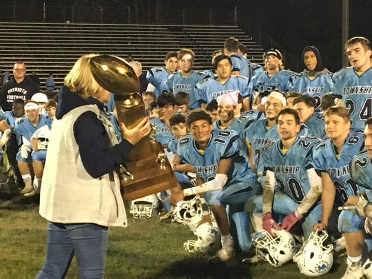 Freehold Township receiving the Duke Trophy.