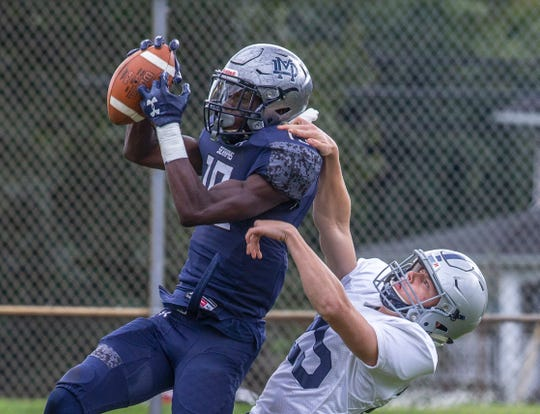 Mater Dei's Isaiah Alston pulls in a touchdown pass in left corner for a first half touchdown. Manasquan Football vs Mater Dei in Middletown, NJ on October 13, 2018.