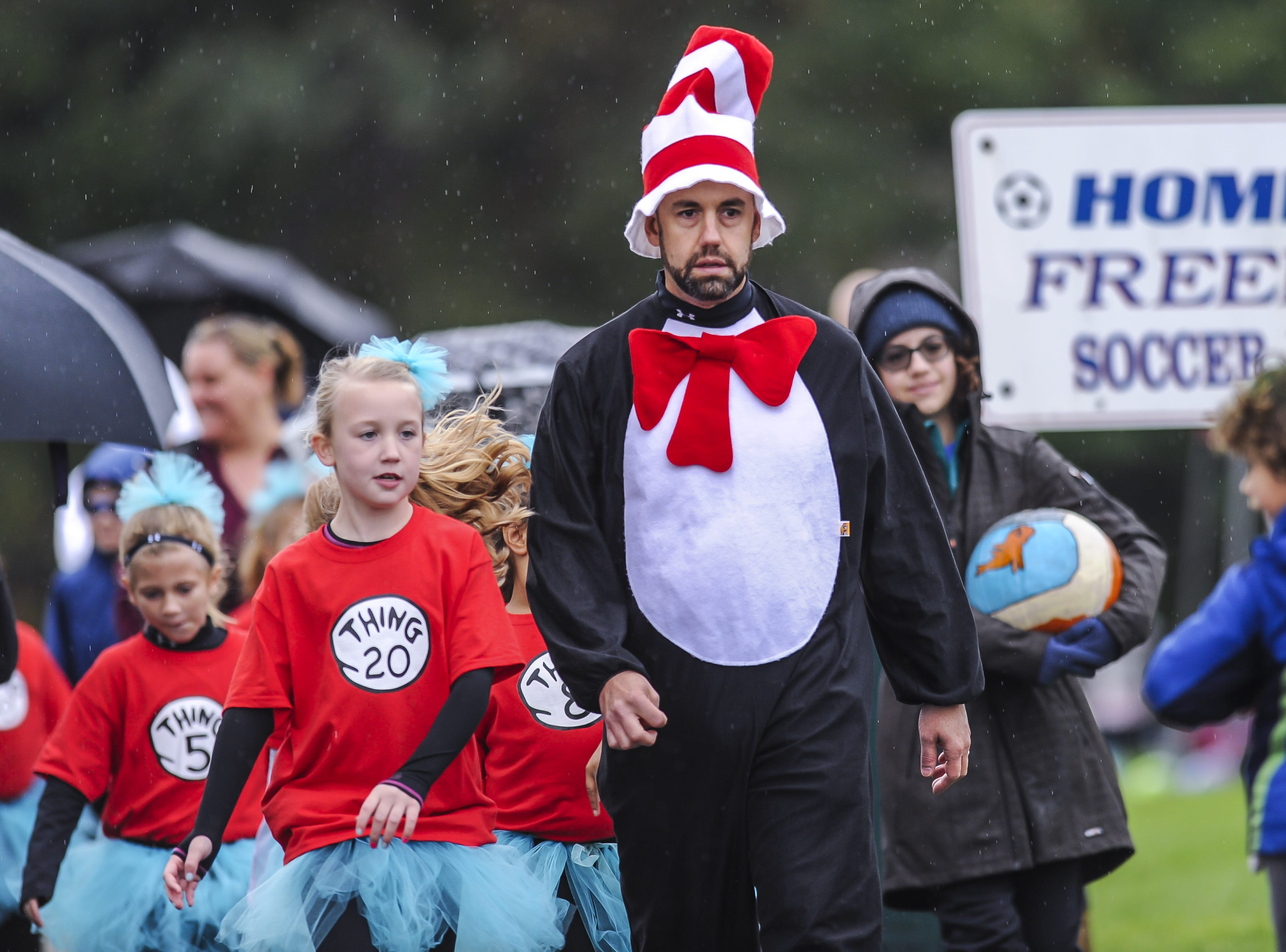 Head coach Rob Smith of the Jackson Vipers, wearing a Cat In the Hat costume at Michael J. Tighe Park in Freehold on Oct. 13, 2018. Freehold Soccer League hosted their 20th Halloween-themed Fright Fest Tournament where teams wear Halloween costumes as uniforms and the fields are decked out with spooky decorations.