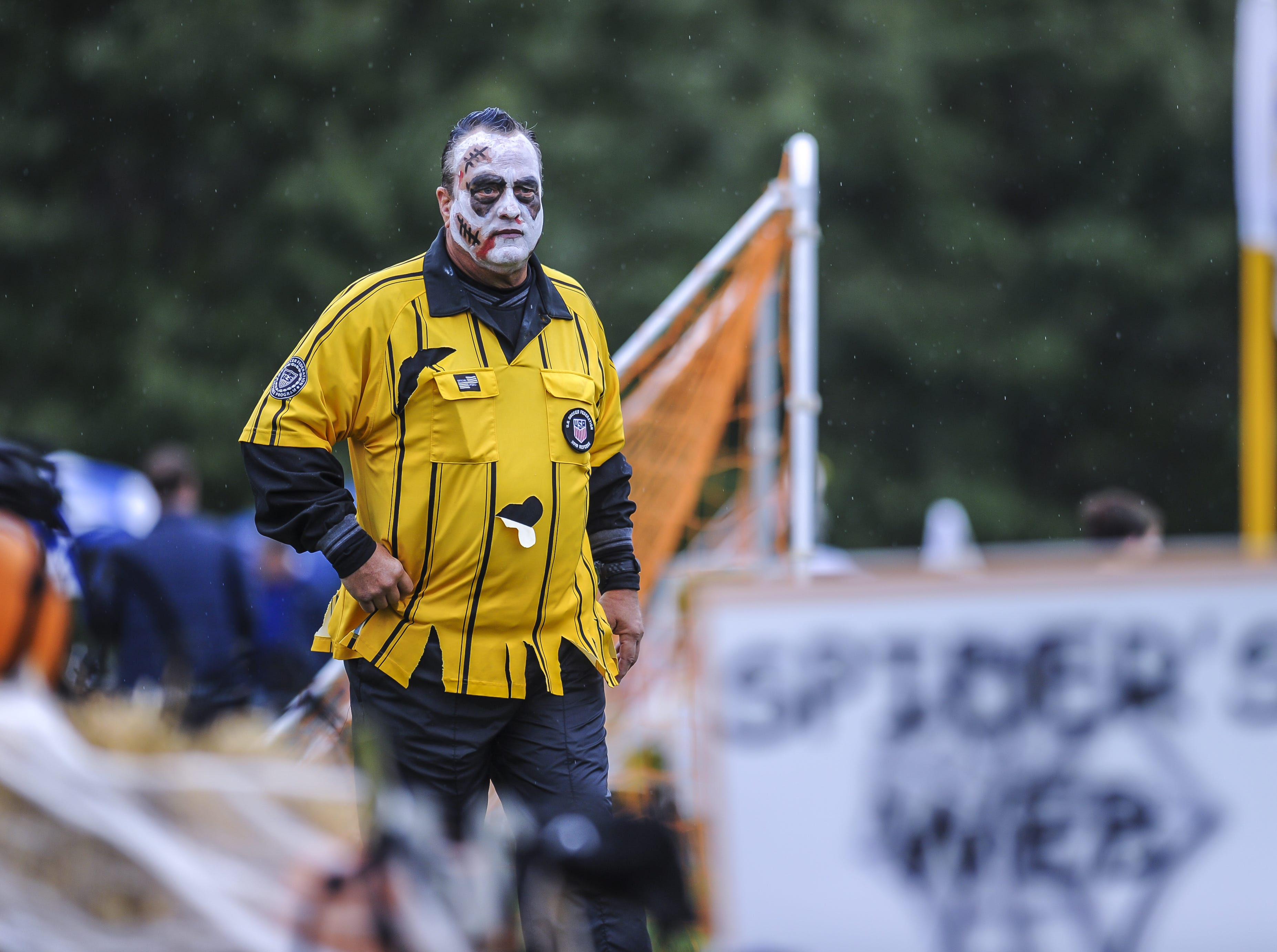 Referee Bob Coleman waits for his game to start at the Freehold Soccer League Halloween-themed Fright Fest Tournament at Michael J. Tighe Park in Freehold on Oct. 13, 2018. Freehold Soccer League hosted their 20th Halloween-themed Fright Fest Tournament where teams wear Halloween costumes as uniforms and the fields are decked out with spooky decorations.