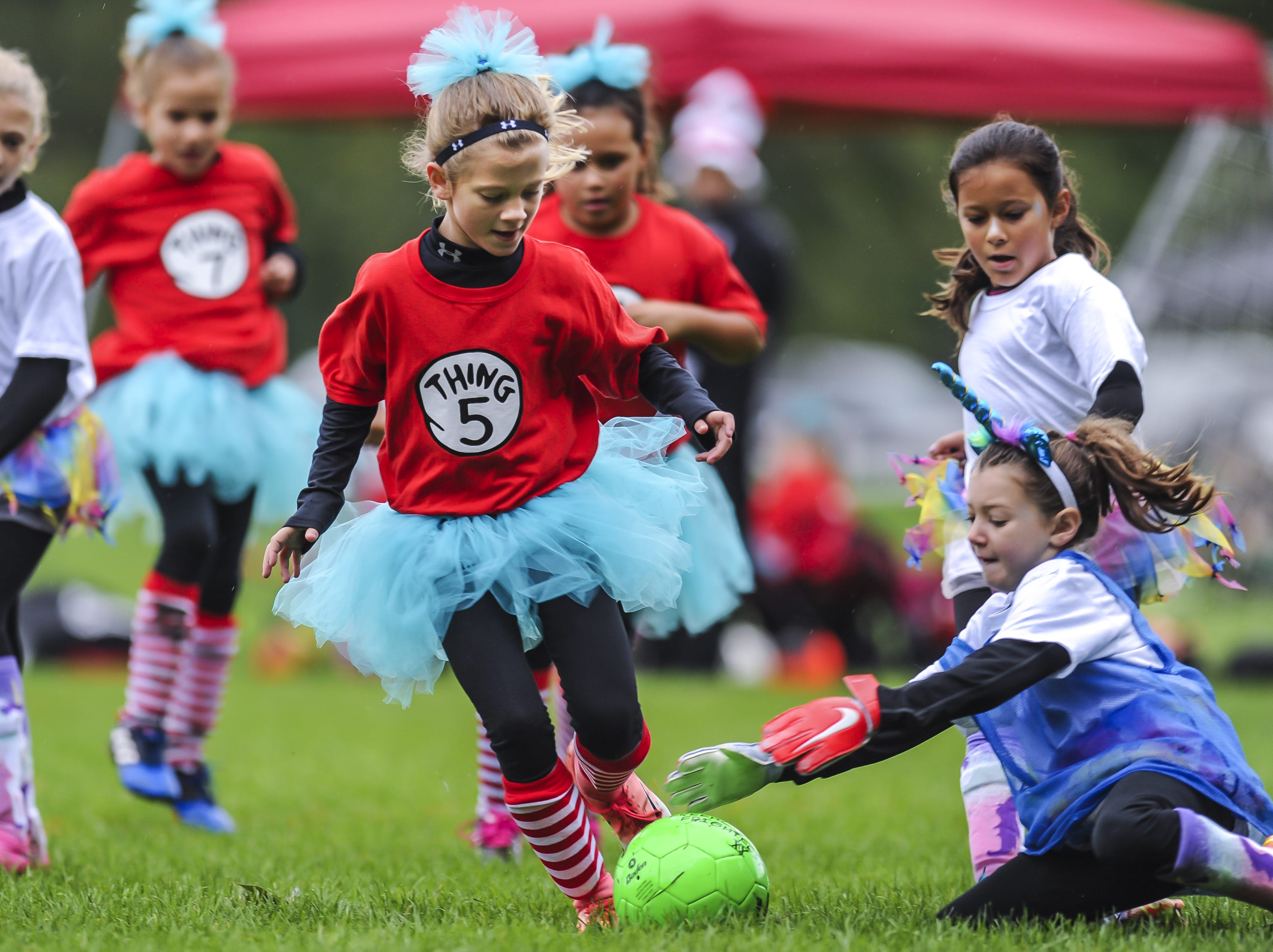 Addison Blackburn of the Jackson Vipers tries to maneuver the ball around goalkeeper Sienna Levine of Manalapan Sky Blue at Michael J. Tighe Park in Freehold on Oct. 13, 2018. Freehold Soccer League hosted their 20th Halloween-themed Fright Fest Tournament where teams wear Halloween costumes as uniforms and the fields are decked out with spooky decorations.