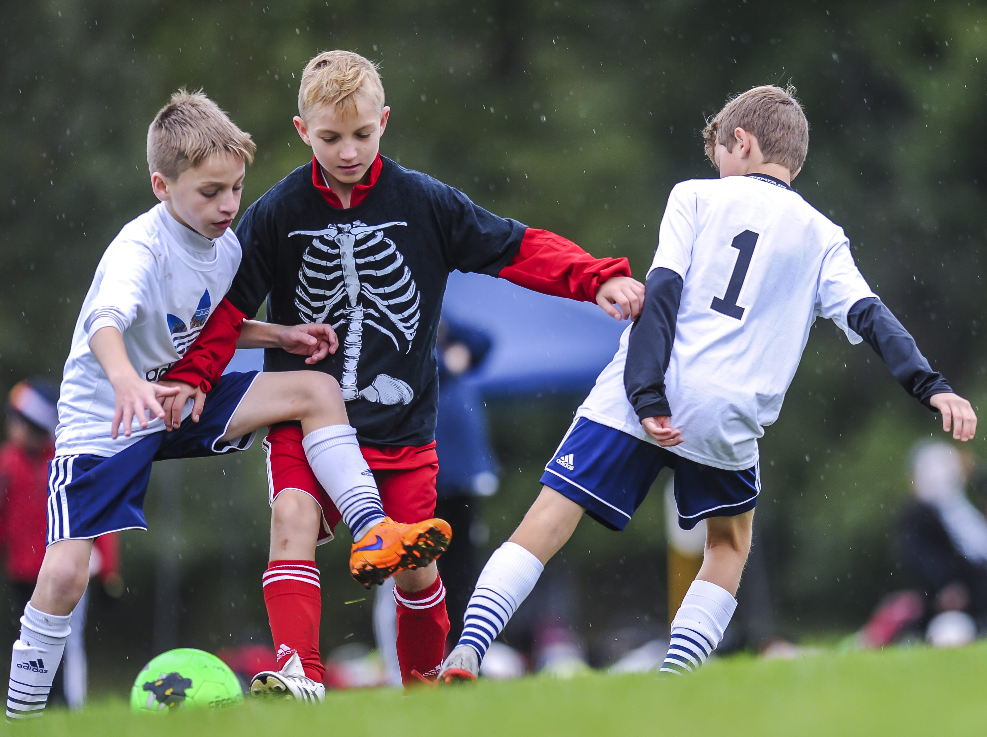Nikita Jouk of Manalapan, gets caught between two Westfield defenders vieing for the ball at Michael J. Tighe Park in Freehold on Oct. 13, 2018. Freehold Soccer League hosted their 20th Halloween-themed Fright Fest Tournament where teams wear Halloween costumes as uniforms and the fields are decked out with spooky decorations.