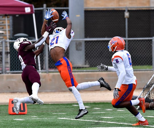 Louisiana College center back Lorenz Clark breaks up a pass meant for McMurry's Trevion Harris during Saturday's game Oct. 13, 2018.