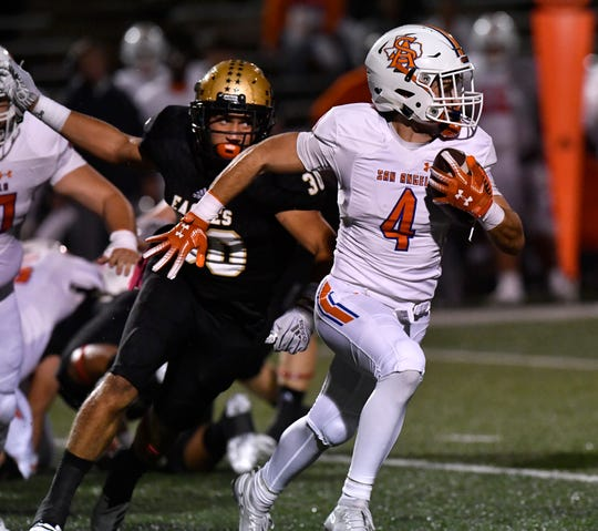 Abilene High linebacker D'Anthony Franklin, left, chases San Angelo Central wide receiver Jackson Timme during last season's game at Shotwell Stadium. Central won 17-15.
