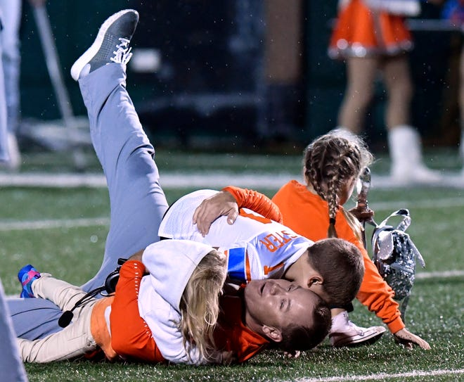 Bobcats defensive coordinator Mark Chester is tackled by his youngest daughter Kaylee (left), son Colton, and daughter Kennedy after San Angelo Central won their game against Abilene High Friday Oct. 12, 2018. Final score was 17-15.
