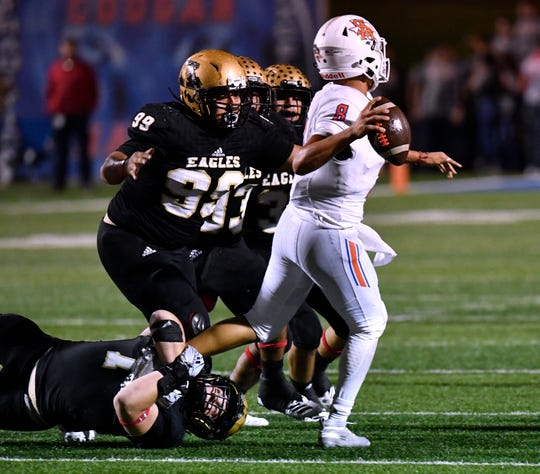 Abilene High's Colton Wilson holds on to the foot of San Angelo Central quarterback Malachi Brown as Brown tries to throw a pass during Friday's game Oct. 12, 2018. Final score was 17-15, San Angelo.