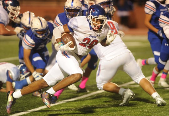 Cooper running back Aeneas Favors (29) runs for an 11-yard touchdown on the game's opening drive against Amarillo Palo Duro. Favors score came with 9:52 left in the opening quarter. Cooper won the District 2-5A Division I game Friday at Dick Bivins Stadium in Amarillo.