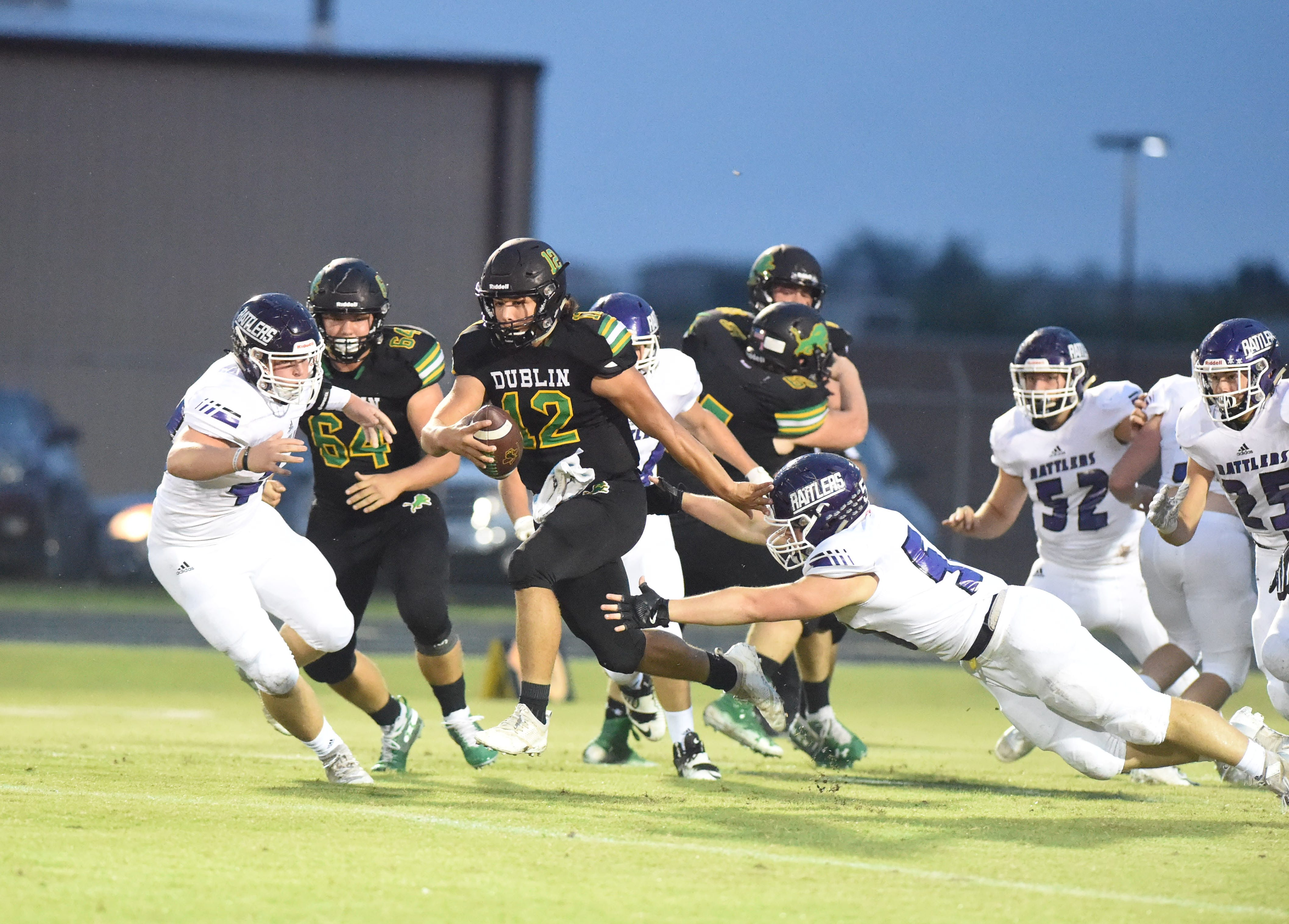 Dublin quarterback Cy Wing (12) sheds a tackle on the way to a 46-yard run in the first quarter against Tolar on Oct. 12, 2018 at Memorial Stadium.