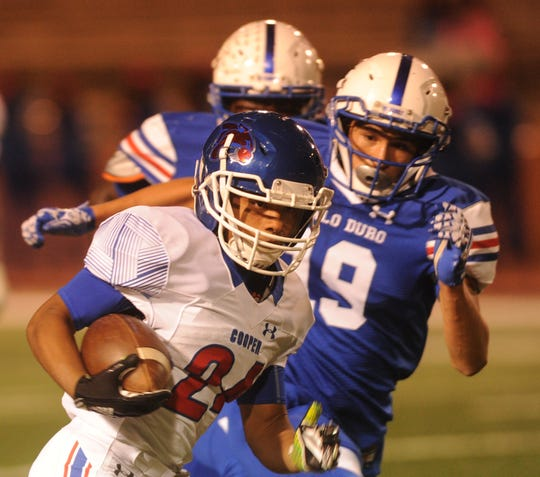 Cooper's Jessus Minjivar (24) runs for a 53-yard TD as the Amarillo Palo Duro defense gives chase. Minjivar's run gave the Coogs a 21-0 lead with 58.4 seconds left in the first quarter.