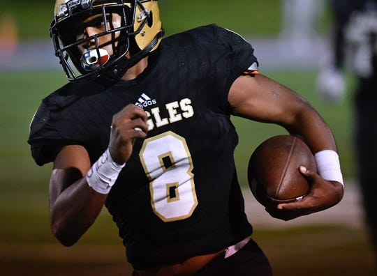 Abilene High's Phonzo Dotson carries the ball during the Eagles' game against San Angelo Central on Friday at Shotwell Stadium. AHS led 15-14 late in the game but a Bobcats' field goal as time expired won the game for the visiting team.
