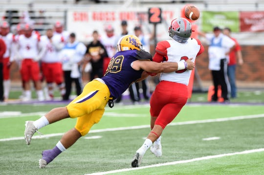 Hardin-Simmons defensive lineman Kyle Zavala (98) forces Sul Ross State quarterback Fabian Baeza (3) to throw the ball away.