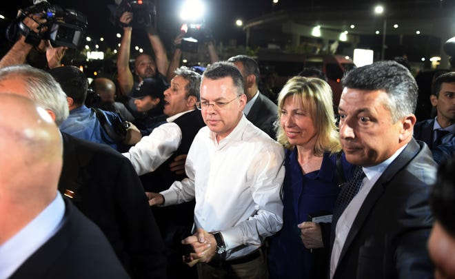 Pastor Andrew Brunson, center left, and his wife Norine Brunson arrive at Adnan Menderes airport for a flight to Germany after his release following his trial in Izmir, Turkey, on Oct. 12, 2018. A Turkish court on Friday convicted an American pastor of terror charges but released him from house arrest and allowed him to leave Turkey, in a move that is likely to ease tensions between Turkey and the United.