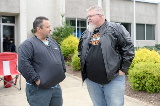 "Republican candidate for Sheriff of Buncombe County Shad Higgins talks with Greg Stephens, the retired chief of the Weaverville Police Department, during a Cops for Kids Bike Run event in Weaverville on Oct. 13, 2018. ""I think it's great to see him here, it shows a lot of interest in what is going on in Buncombe County. It shows that he cares,"" Stephens said about Higgins."