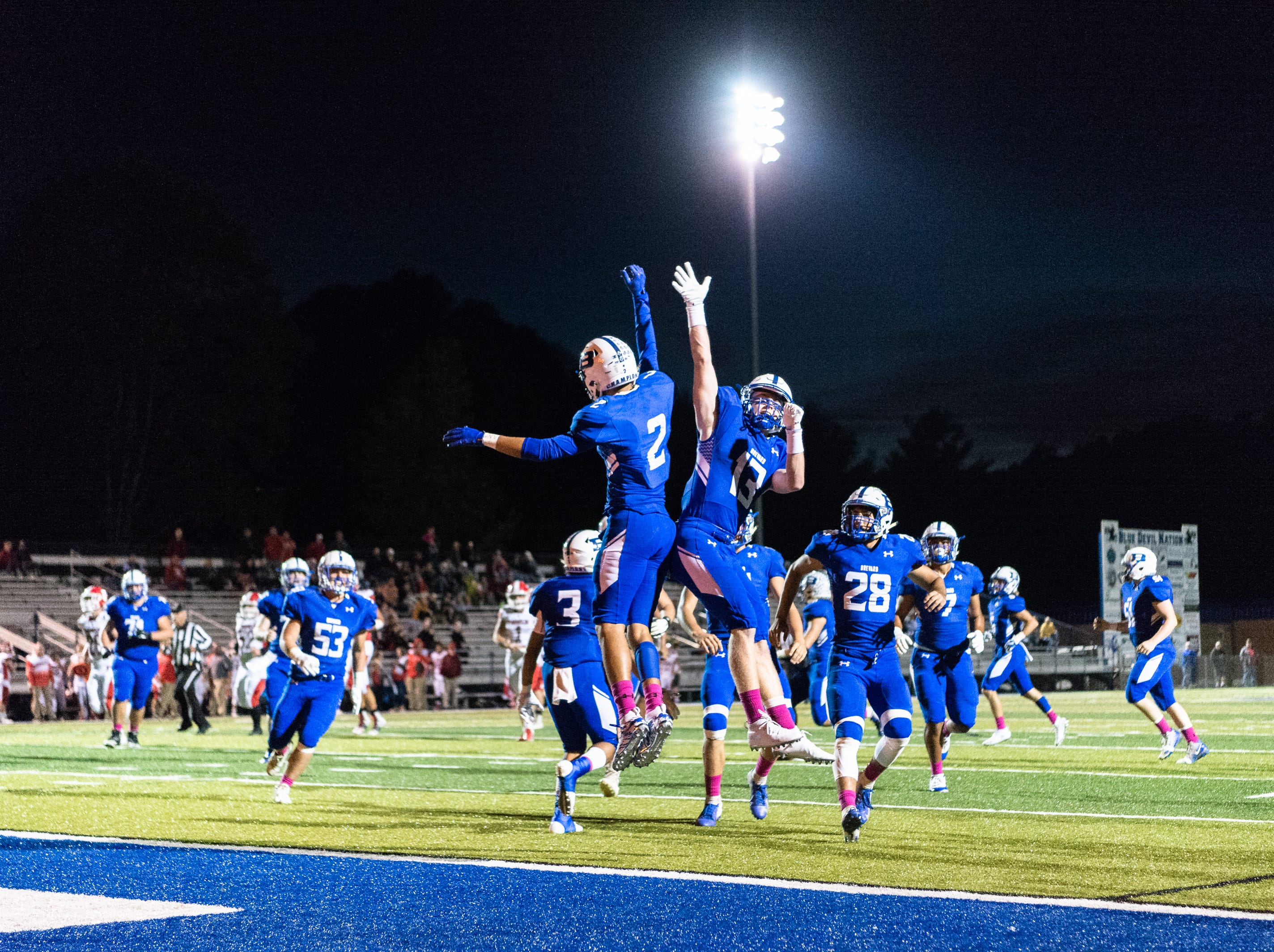 Brevard's Breylan Owens and Luke Ellenberger celebrate a touchdown during their Friday night football game against Franklin, Oct. 12, 2018.