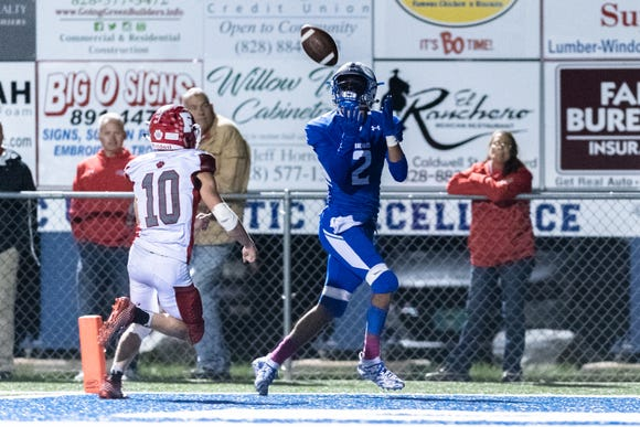 Brevard's Breylan Owens makes a catch in the endzone for a touchdown before Franklin's Tyler Harrison can break it up during their Friday night football game, Oct. 12, 2018.