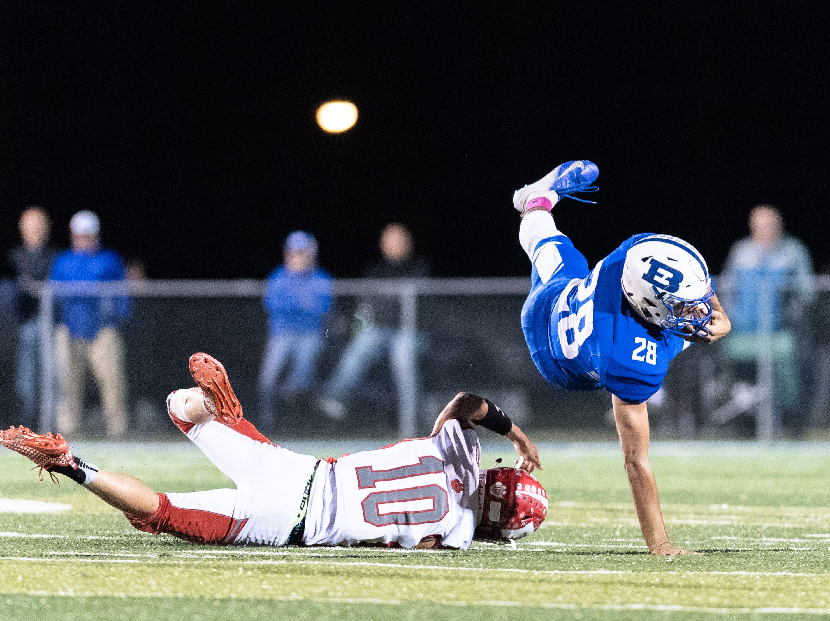 Franklin's Tyler Harrison takes down Brevard's Anthony Fields during their Friday night football game, Oct. 12, 2018.