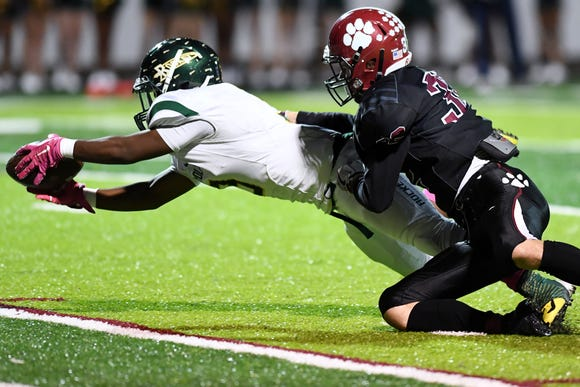 Reynolds's Markeese Jackson dives into the end zone as Asheville's Ben Warren attempts to tackle Oct. 12, 2018. Reynolds won, 37-14.