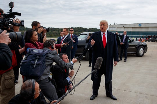 President Donald Trump delivers a statement on the release of Pastor Andrew Brunson from imprisonment in Turkey, at Cincinnati Municipal Lunken Airport for a campaign rally on Oct. 12, 2018, in Cincinnati.