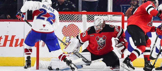 Binghamton goalie Mackenzie Blackwood makes a save on Laval's Alex Belzile on Saturday. Blackwood made 40 saves in the victory.