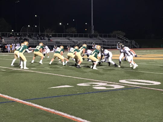 Vestal prepares to run a play against visiting Corning on Friday night. The Golden Bears won, 26-14.