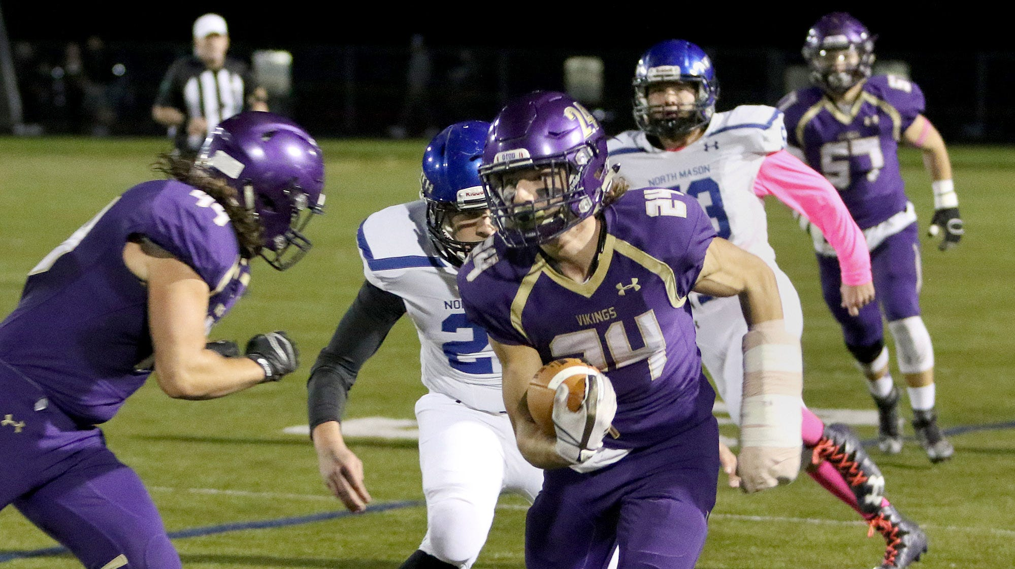 North Kitsap's Riley Solis scored one of his two touchdowns on Friday against North Mason. Solis' Vikings defeated the Bulldogs, 53-6.