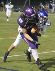 North Kitsap's Aidan Allsap drags a North Mason defender toward the goal line during the Vikings' 53-6 win on Friday in Poulsbo.