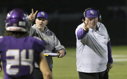 North Kitsap head coach Jeff Weible (right) and the Vikings have won four consecutive games and head into Week 8 in second place in the Olympic League 2A.
