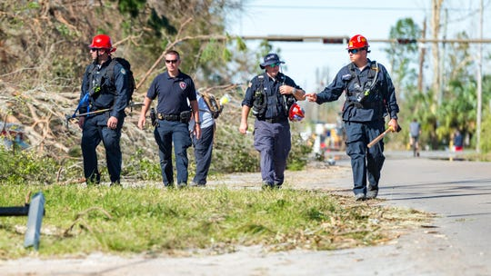 Firefighters from Jefferson Parish, LA perform search and rescue in neighborhoods around Panama City, FL. Friday, Oct. 12, 2018.