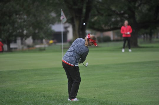 Shelby's Lexi Uplinger chips onto the 14th green at Ohio State University's Scarlet Course.