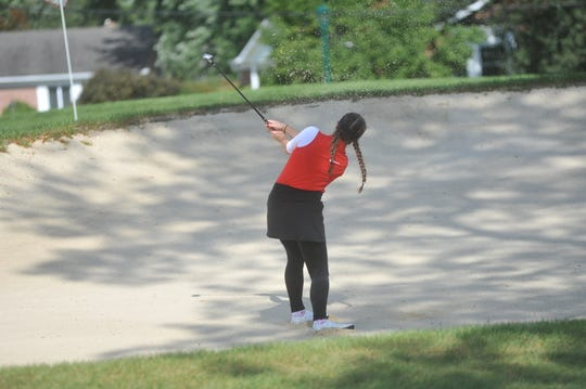 Shelby's Amanda Ruminski hits out of the bunker near the 15th green Saturday on Ohio State's Gray Course.