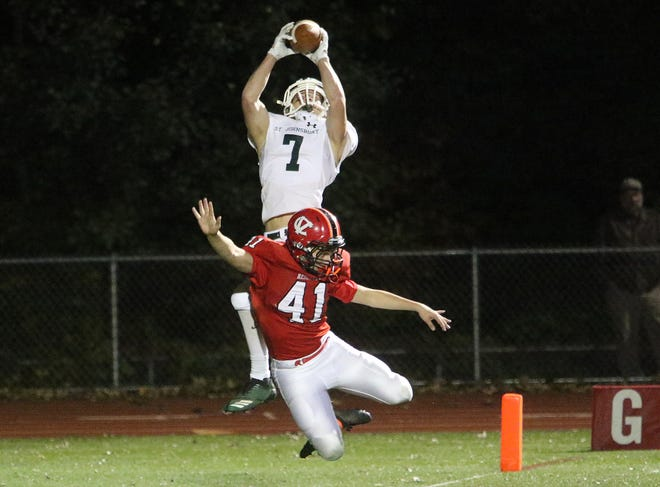 Hunter Palmieri leaps for a touchdown catch in St. Johnsbury's 42-0 win over CVU on Friday.
