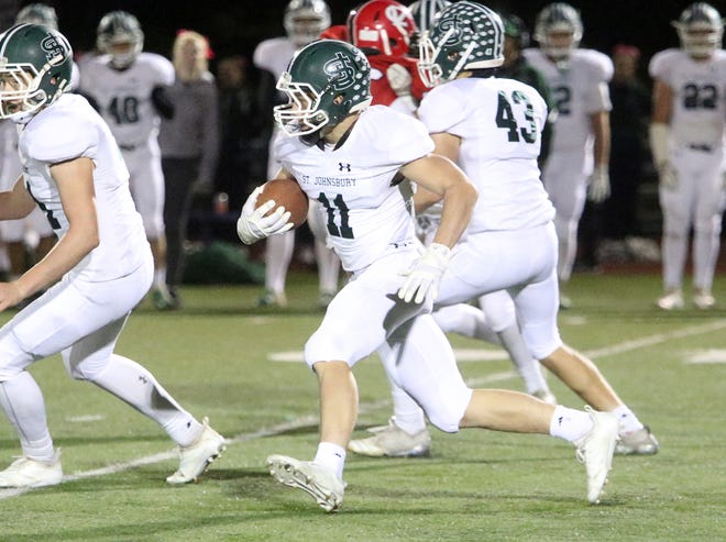 St Johnsbury junior Wilder Hudson breaks free for a big gain late in the Hilltoppers 42-0 win over CVU. The game was held under the lights on a nuetral field at Burlington's Buck Hard Field Friday night.