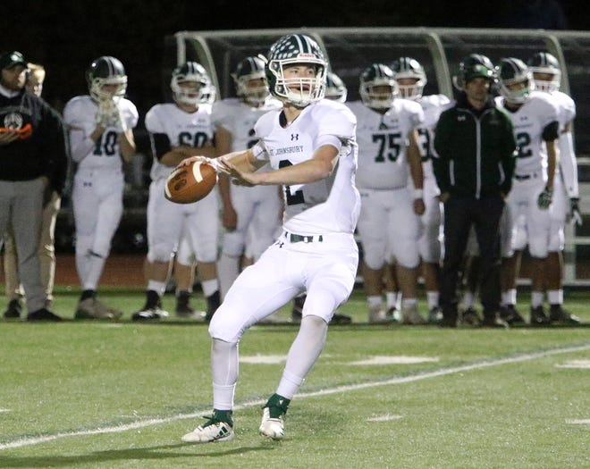 St Johnsbury's Jake Cady surveys the field before firing down the field for yet another long completion during the Hilltoppers 42-0 win over CVU. The do it all QB put on a show on the turf at Burlington's Buck Hard Field Friday night as the Hilltoppers dominated from the opening kickoff.