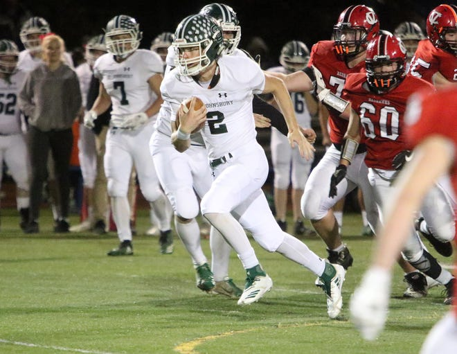 Duel threat QB Jake Cady takes off and runs for a huge gain during St Johnsbury's 42-0 runaway win over CVU on Friday night.