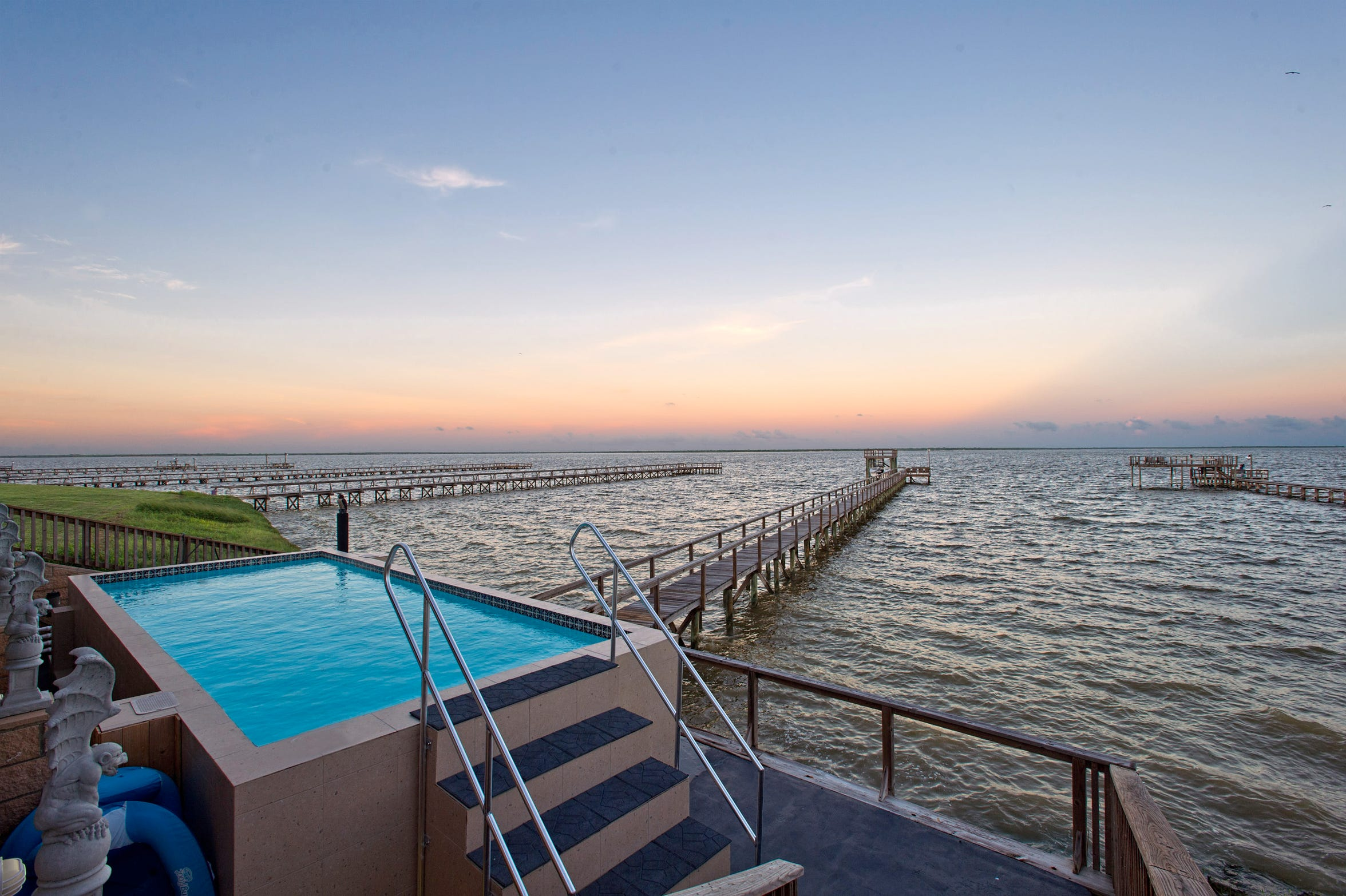 Climb into the unique swimming pool on the shore of Baffin Bay, home to some of the best fishing on the Texas coast.  All this plus a 300' private lighted fishing pier w/fish cleaning station and electric boat lift.