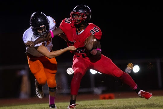 West Oso's Cameron Williams runs the ball against Orange Grove during the second half of their game at Bear Stadium Friday, Oct. 12, 2018.